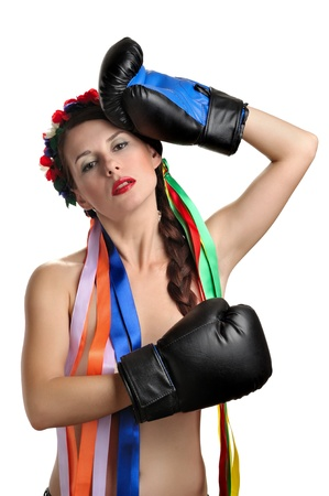 Topless girl with boxing gloves and floral wreath on her head isolated on white background photo