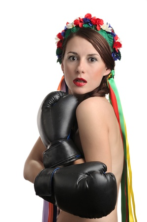 Frightened woman with boxing gloves and floral wreath on her head isolated on white background photo