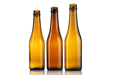 Three empty bottles of beer isolated on white background  photo