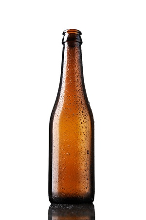 Empty bottle of beer with drops isolated on white background