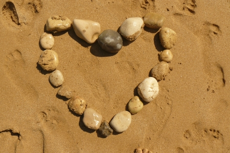 Love heart from pebbles on a tropical beach Stock Photo - 14254659
