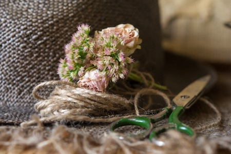 Still life of scissors,small bouqet with flowers and cord Stock Photo