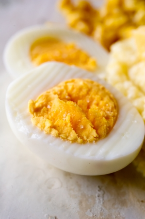 Boiled salted  eggs cut in half  Shallow DOF photo