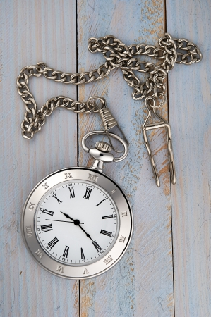 Photo of silver vintage pocket watch with chain on wooden background Stock Photo - 16834002
