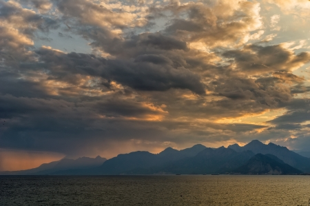 Dramatic lanscape of a sunset over the mountains and the sea Stock Photo - 17915950