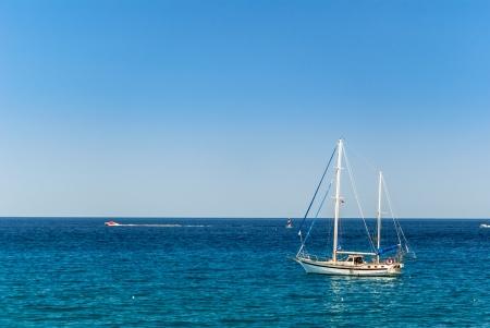 Small sailing yacht on the calm sea Stock Photo - 17915989