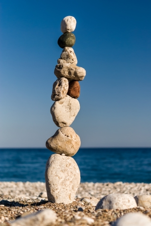 Macro of zen stones staked in tower on the beach Stock Photo - 17915965