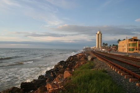 Ocean - Train track - Skyscapers photo