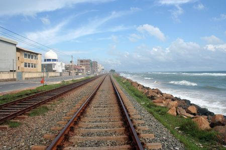 railway track , Blue sky and the sea Stock Photo