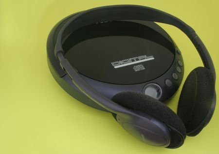 Black Headphones and a cd player photo