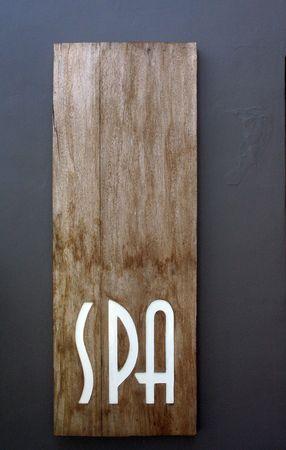 spa board on wood - textured wall Stock Photo
