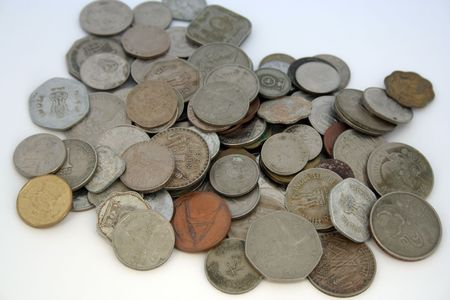 Business concept - with many coins of different countries Stock Photo