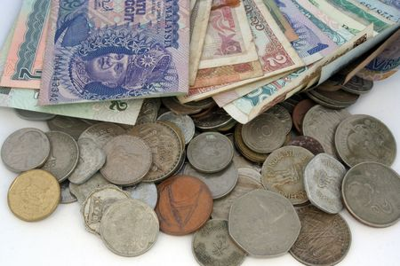 Business concept - with many notes & coins of different countries