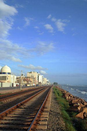 railway track , Blue sky and the sea Stock Photo