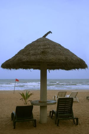 deckchair on a tropical beach with sky and white sand Stock Photo - 1319789