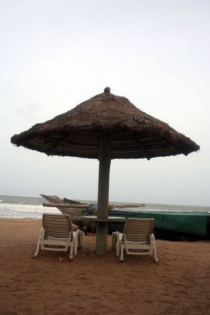 Umbrella and chairs on tropical beach in Negambo, Sri Lanka. photo