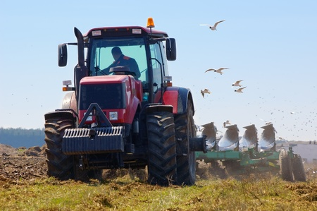 Farmer plowing the new field in spring