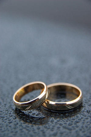 Wedding rings with rain drops Stock Photo