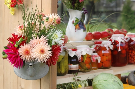 Harvest theme with canned fruit and vegetables