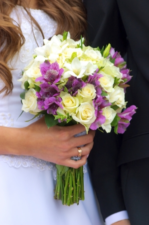 Wedding bouquet in bride s hand