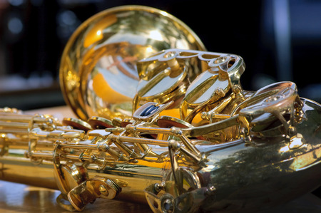 Golden saxophone background Stock Photo