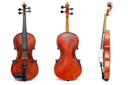 Old used violins view Stock Photo