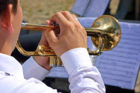 Musician playing on trumpet in the street orchestra Stock Photo