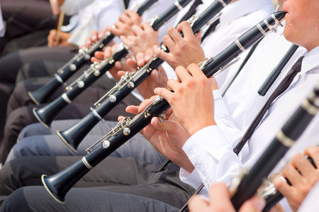 Musicians playing clarinet in street orchestra Stock Photo