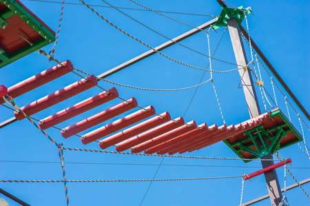 Rope park on a sunny summer day under blue sky. The concept of sports and tourism Stock Photo
