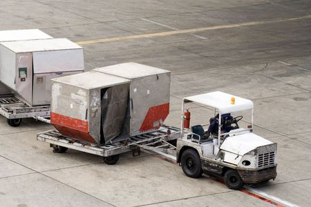 consignment: Delivering containers to the plane Stock Photo