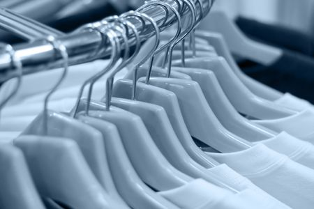 Clothes on hangers at the shop, shallow DOF, toned version Stock Photo - 406928