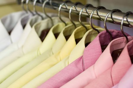 Shirts on hangers at the show, shallow DOF, b&w version Stock Photo - 406942