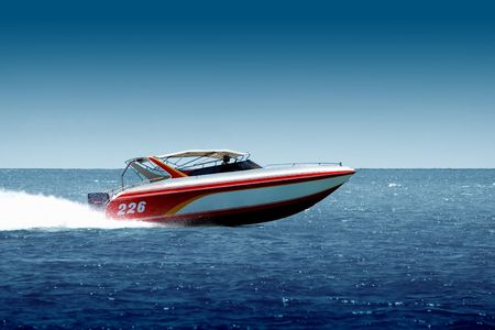 Speedboat cruising in the sea Stock Photo