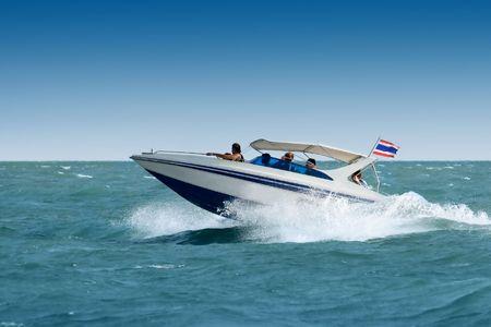 beach cruiser: Motorboat in the sea Stock Photo