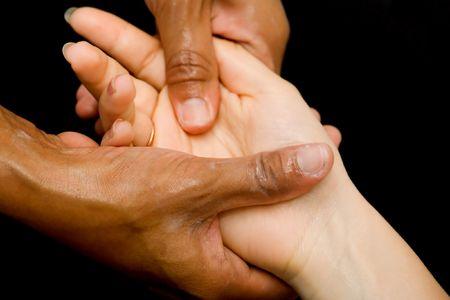 Hand massage, isolated on black Stock Photo - 410562