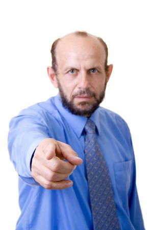 Man in a tie pointing at you, focused on hand, face and body out of focus Stock Photo