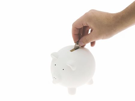 stow: Hand inserting a coin in the piggy bank Stock Photo