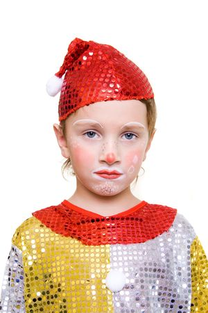 An unhappy boy, dressed as clown on a holiday Stock Photo - 601468