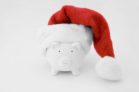 A piggy bank with a christmas hat photo