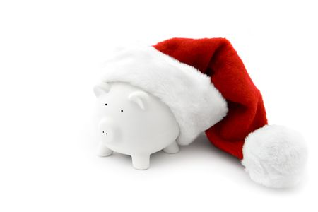 A piggy bank with a cristmass hat photo