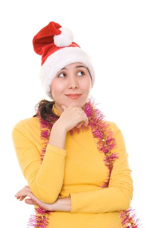 A thoughtful asian girl in santas hat, isolated on white. photo