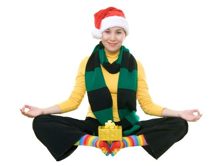 traditional wellness: Funny asian girl in santas hat meditating, isolated on white Stock Photo