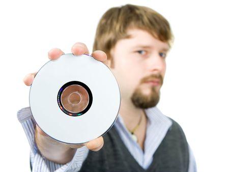 Man displaying cd or dvd, focused on cd photo