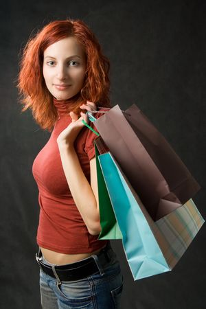 Young woman with shopping bags, isolated on black Stock Photo - 667443