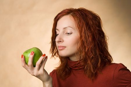 Portrait of woman with a green apple Stock Photo - 667444