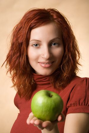 Portrait of womant with a green apple Stock Photo - 667442