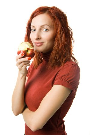 Woman eating red apple, isolated on white