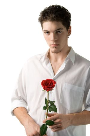 A young man with rose, isolated on white photo