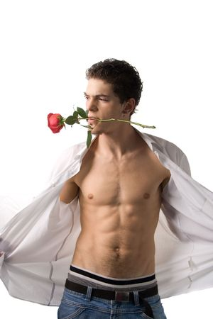 A sexy young man with rose undressing, isolated