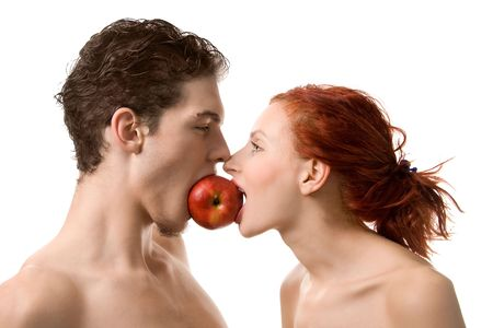 Couple biting an apple, isolated on white photo
